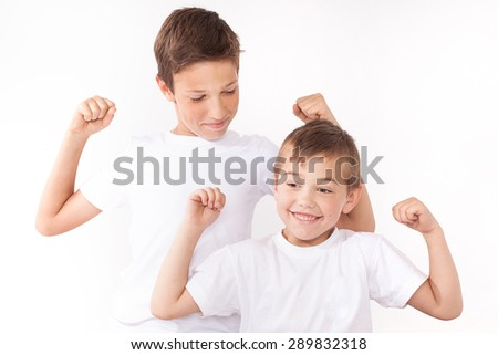 Two brothers posing at home, smiling. Family portrait. - stock photo