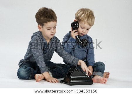 Two brothers posing in studio with telephone