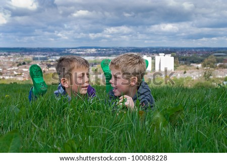 Two brothers sharing happy times in the countryside. - stock photo