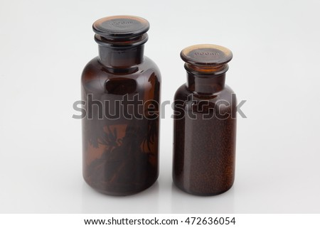 Two brown glass bottles on a white background