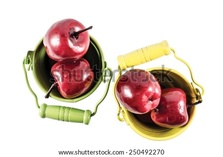 Two buckets with red apples isolated over white - stock photo
