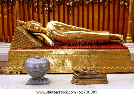 Two Buddha Statues lying down - stock photo
