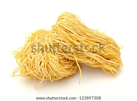 two bunch of dried noodle on white background - stock photo