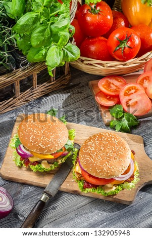 Two burgers and fresh vegetables