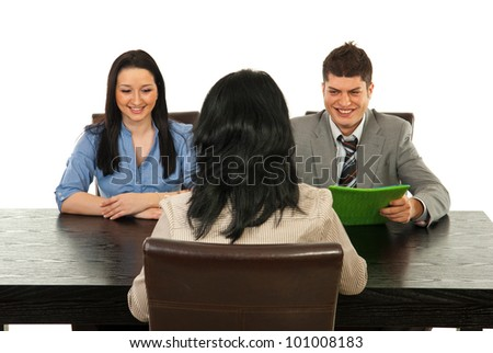 Two busines speople having interview with manager woman in office