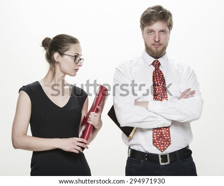Two business colleagues, businessman standing with his female colleague smiling and looking to you, teamwork concept, isolated on white