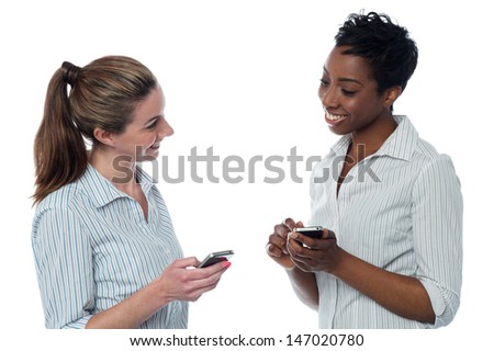 Two business colleagues exchanging phone numbers - stock photo