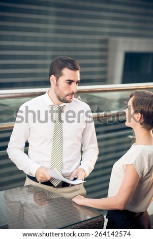 Two business colleagues having conversation - stock photo