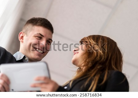 Two business colleagues working on a project, analyzing data  - stock photo