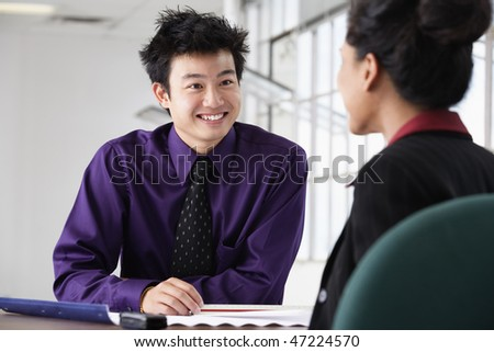 Two business executives discussing in office.