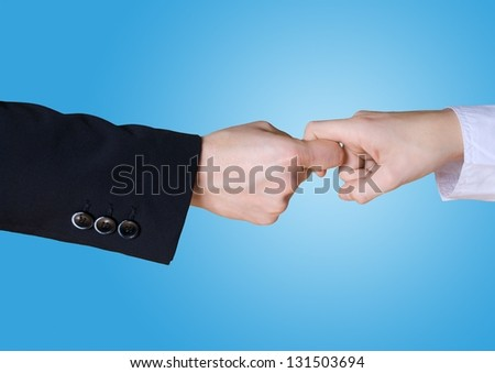 two business hands in rivalry on a blue background - stock photo