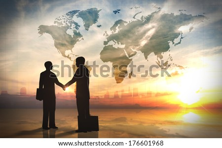 Two business man shake hand silhouettes city with world maps. - stock photo