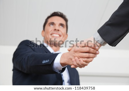 Two business manager shaking hands in the office - stock photo
