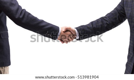 Two business men in suits shake hands