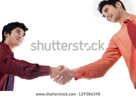 Two business men shaking hands on white background - stock photo