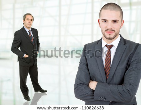 two business men standing at the office - stock photo