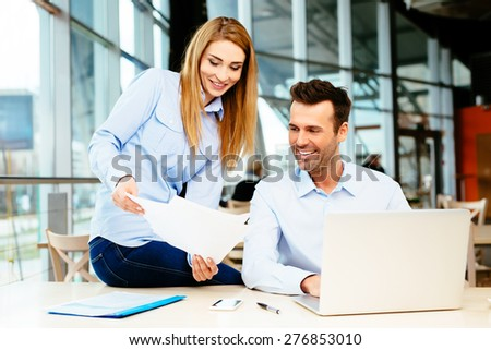 Two business partners discussing issues at a meeting in an office - stock photo