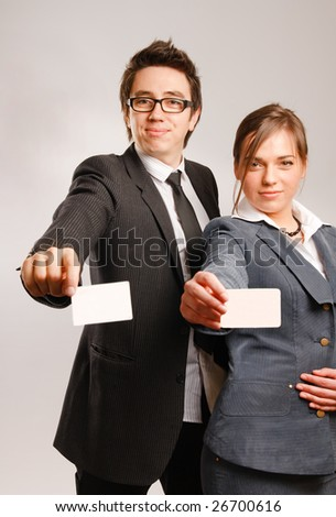 Two business partners holding blank business cards - stock photo