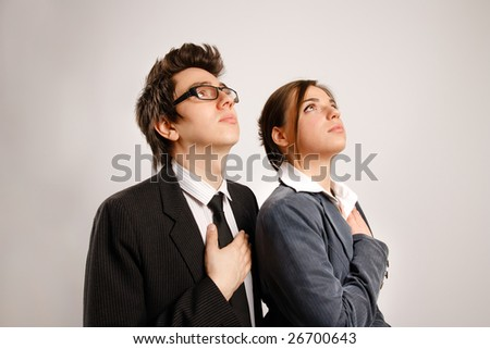 Two business partners looking up - stock photo