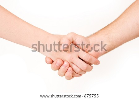 Two business partners shaking hands - close up, copy space