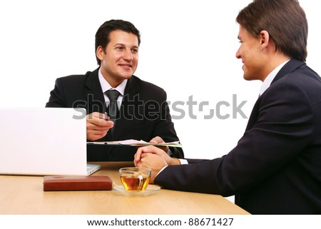 Two business partners signing contract isolated on white background - stock photo