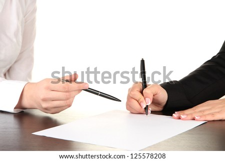 Two business partners signing document, isolated on white - stock photo