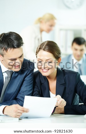 Two business partners sitting in office and discussing plan - stock photo