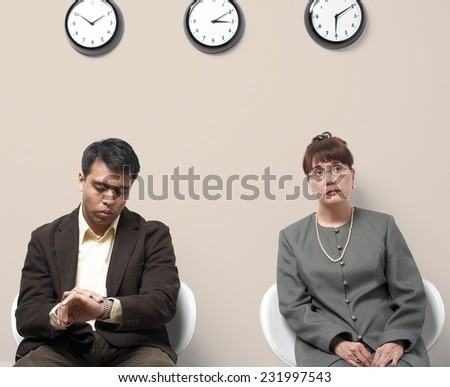 Two Business People Anxiously Waiting