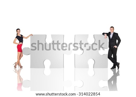 Two business people are standing near puzzle parts in order to succeed on the white background.
