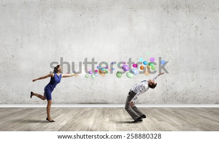 Two business people fighting with each other - stock photo
