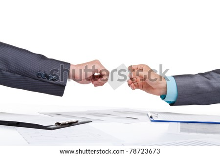 Two business people hands in elegant suits sitting at desk and give blank empty card, working in team together with documents sign up contract. Isolated over white background. - stock photo