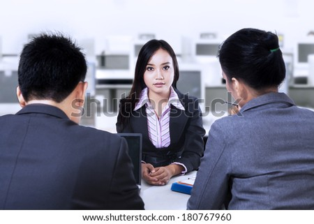 Two business people having a interview with job applicant - stock photo