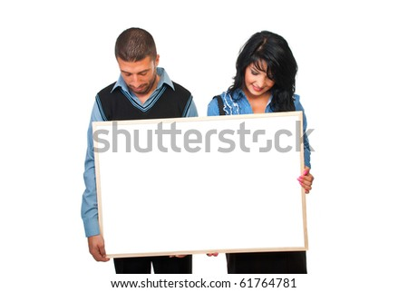 Two business people holding a cardboard and looking down to copy space isolated on white background