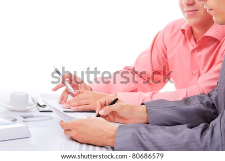 Two business people in elegant suits sitting at desk working in team together with documents sign up contract, holding clipboard, folder with papers, business plan. Isolated over white background. - stock photo