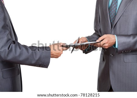 Two business people in elegant suits standing working in team together and discussing the problem looking into clipboard, folder with papers, document, business plan. Isolated over white background.