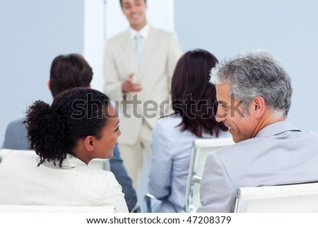 Two business people interacting at a conference in the office - stock photo