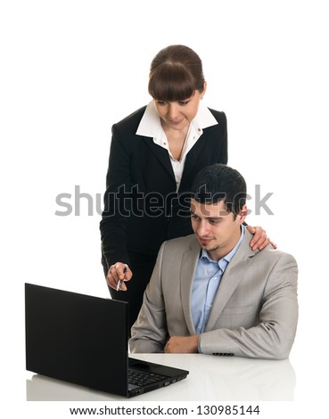 Two business people looking documents - stock photo