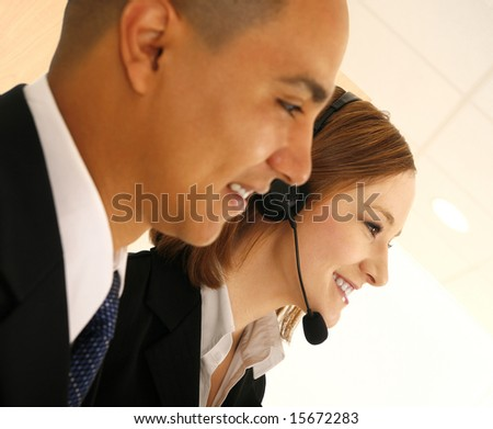 two business people looking to the side. the woman wearing headset talking to customer service. concept for customer service or customer care