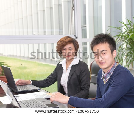 Two business people meeting, focus on the man - stock photo