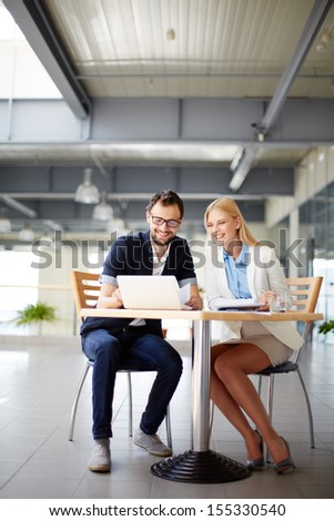 Two business people networking at meeting  - stock photo