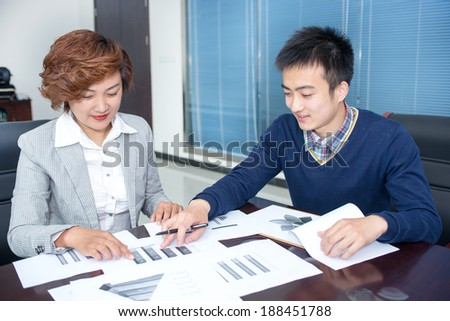 Two business people show analysis diagram, business discussion  - stock photo