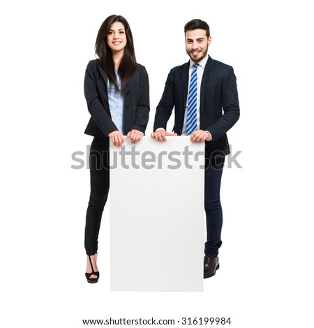Two business people showing a blank boards - stock photo