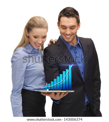two business people showing tablet pc with hologram of graph - stock photo