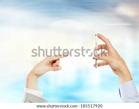 Two business people using one mobile phone at the same time - stock photo