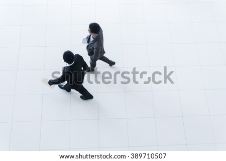 Two business people walking, high angle