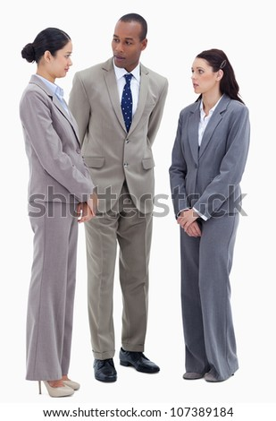 Two business people watching their copworker against white background - stock photo