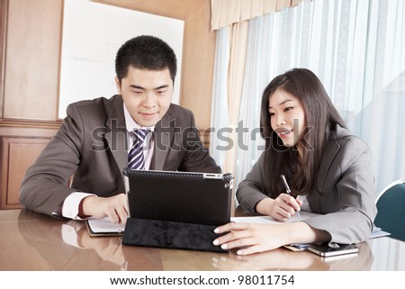 Two business people working together in the office