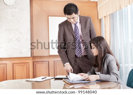 Two business people working together in the office - stock photo