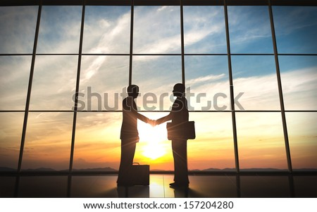 Two Business shake hand silhouettes rendered with computer graphic. - stock photo