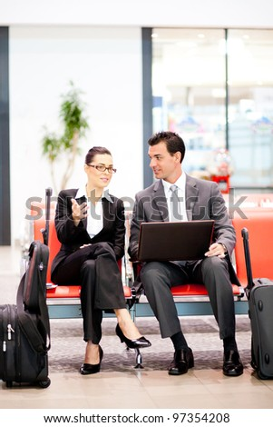two business travellers waiting for flight at airport - stock photo